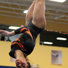 Beverly: Beverly junior gymnast Heather Gomes twists around and flips upside-down while making her dismount on the beam at the Sterling Center YMCA on Friday evening. DAVID LE/Staff Photo 1/31/14