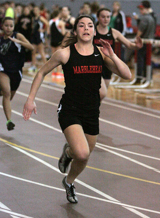 Ken Yuszkus/Staff photo: Marblehead: Marblehead's Alyssa Nye wins her heat in the 55 meter dash at the North Shore Tech at Marblehead boys/girls indoor track meet.