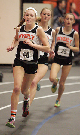 Ken Yuszkus/Staff photo: Beverly:  Beverly's Julianna Wesley takes the early lead in the girls mile race at the Salem at Beverly indoor track meet.