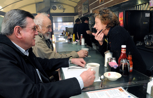Ken Yuszkus/Staff photo: Salem:  From left, customers Ralph Berry and Barry Pierce talk with waitress Liza Cooper at the counter of The Salem Diner on Wednesday morning.