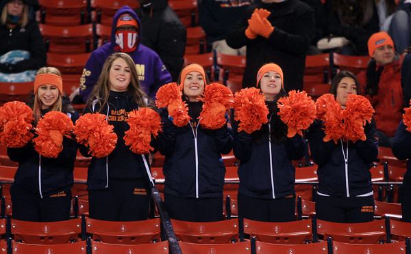 Boston: The Salem State cheerleaders try to stay warm during the Vikings Frozen Fenway game against UMass Boston on Tuesday afternoon. The Vikings fell to the Beacons 4-2. DAVID LE/Staff Photo
