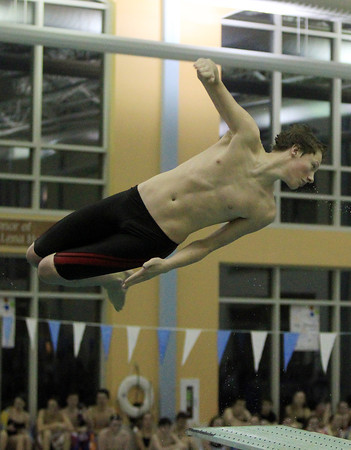 Peabody: Marblehead junior Jake Driscoll twists in midair during this third dive against Peabody on Thursday evening at the Torigian Family YMCA. DAVID LE/Staff Photo
