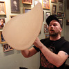 Salem: Tyler Griffin, of Flying Saucer Pizza Company in downtown Salem, is trying to go to the Olympics of Pizza Making and is hoping to break the world record for pizza dough stretching. Griffin spins a pizza high in the air on Thursday afternoon. DAVID LE/Staff Photo