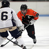 Lynn: Beverly senior captain Nicole Woods (4) carries the puck up-ice while being defended by St. Mary's senior Tatiana Doucette (6) during the second period of play on Saturday evening. DAVID LE/Staff Photo