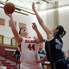 Salem: Salem's Jaclyn Panneton (44) goes up strong to the hoop and converts a layup while being defended by Peabody's Danielle Sullivan (33) on Tuesday evening. DAVID LE/Staff Photo