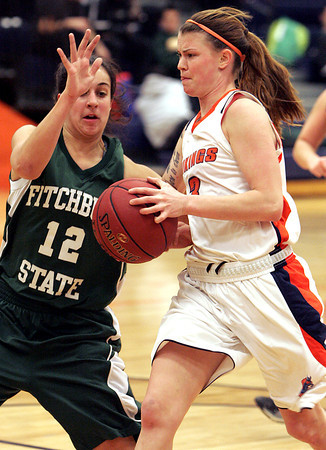 Ken Yuszkus/Staff photo: Salem: Salem's Rachel Ledbetter goes in for a shot with Fitchburg's Rebecca Fluet at her side during the Fitchburg State at Salem State women's basketball game.