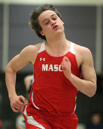 Ipswich: Masco senior Austin Cashin wins his heat of the 300 against Hamilton-Wenham on Friday afternoon. DAVID LE/Staff Photo