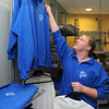 Ken Yuszkus/Staff photo: Danvers: Danvers High School senior Joe Poirier arranges the merchandise for sale at the Falcon's Nest which is a student run store at the school.