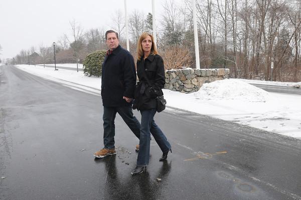 Ken Yuszkus/Staff photo: Danvers: John and Kelly Packowski walk across Village Road at Ferncroft Road.