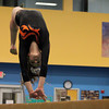 Beverly: Beverly gymnast Kara MacGilvary springs backwards during her beam routine against Masco at the Sterling Center YMCA on Friday evening. DAVID LE/Staff Photo 1/31/14