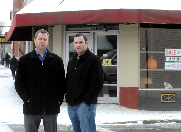 Ken Yuszkus/Staff photo: Beverly: Jay Goldberg and Andy Goldberg of Goldberg Properties of Beverly, which is buying the former Bell Market building in the background.