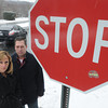 Ken Yuszkus/Staff photo: Danvers: John and Kelly Packowski stand near the stop sign that does not stop most cars on Village Road near the intersection of Ferncroft Road.