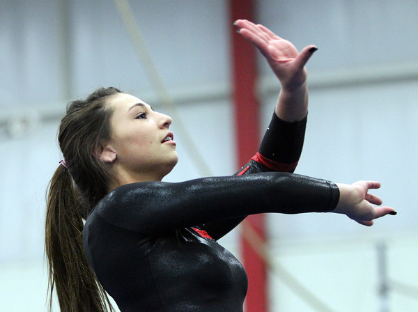 Beverly: Masco gymnast Jordan Gallo performs her floor routine against Beverly at the Sterling Center YMCA on Friday evening. DAVID LE/Staff Photo 1/31/14