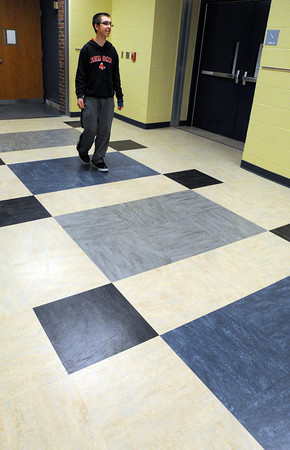 Ken Yuszkus/Staff photo: Salem: 8th grade student Matthew Sheldon walks across the new flooring on the 2nd floor hallway at the Collins Middle School.