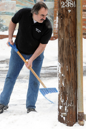 Ken Yuszkus/Staff photo: Beverly:  Scott Ofiesh shovels the parking lot at Gloria Foods in a T-shirt despite the severe cold and biting wind on Wednesday morning. He was outside shoveling for a while. The low temperatures and wind will stick around for a few days.