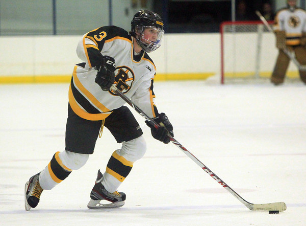 Peabody: Bishop Fenwick defenseman Greg McGungle (3) lines up a shot from the point against Austin Prep on Saturday evening. The Crusaders fell 11-0 to the Cougars in Catholic Central League action at the McVann-O'Keefe Rink. DAVID LE/Staff Photo