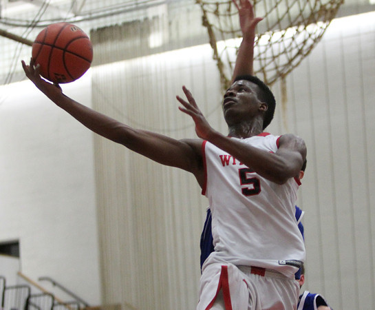 Salem: Salem senior forward David Kazadi (5) glides in for a layup against Danvers during the first half of play. Salem defeated Danvers 41-38 in a closely contested game on Tuesday evening. DAVID LE/Staff Photo 1/14/14