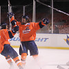 Boston: Salem State University sophomore Chris Mastropietro (17) right, celebrates his second period goal with line mate Kristofer Faric (18) during the Vikings Frozen Fenway game against UMass Boston on Tuesday afternoon. The Vikings fell to the Beacons 4-2. DAVID LE/Staff Photo