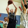 South Hamilton: Pingree sophomore guard Griffin Beal (21) drives hard to the hoop while being met by multiple Concord Academy defenders on Friday evening. DAVID LE/Staff Photo 1/31/14