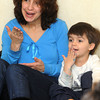 Ken Yuszkus/Staff photo: Beverly: Jackson Merritt, 3, and his mother Rene, gesture while singing a song during story hour for toddlers at the Beverly Public Library on Tuesday morning.