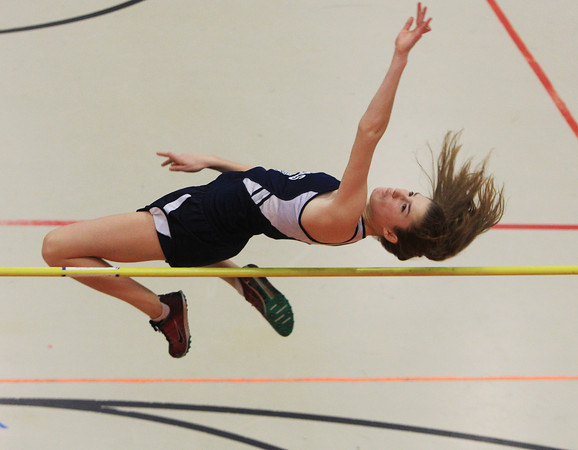 Ipswich: Hamilton-Wenham junior Fiona Worsfold leaps over the high jump bar in a meet against Masconomet on Friday afternoon. DAVID LE/Staff Photo