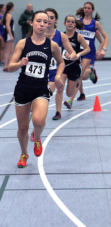Ken Yuszkus/Staff photo: Danvers: Swampscott's Sarah Kelley gets out in front at the start of the womans mile race which she won during the Swampscott at Danvers indoor track meet.