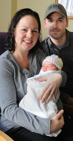 Ken Yuszkus/Staff photo: Salem: Karyn and Eric Fargo with their new born baby Georgia.