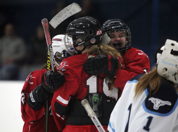 Peabody: Masco's Meghan Hubbard (23) and Jensena Moner (10) congratulate forward Maddy Werner (19) on her second period goal against Peabody on Wednesday afternoon. DAVID LE/Staff Photo
