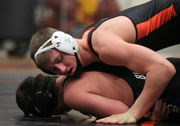 Beverly: Beverly's Tom Wilbur, top, pins Marblehead's Joe Warren against the mat in their 170-lb matchup on Thursday evening. DAVID LE/Staff Photo