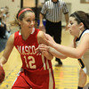 Lynnfield: Masco senior captain Hannah Kiernan (12) tries to drive past Lynnfield senior Rachel Goodwin (10) during the Chieftans 53-45 win over the Pioneers in a matchup between the top two teams in the Cape Ann League on Friday evening. DAVID LE/Staff Photo