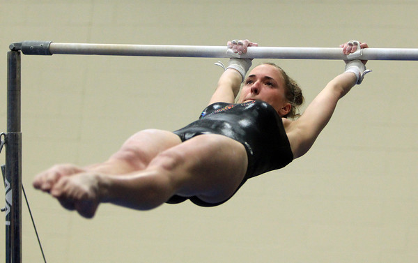 Marblehead: Marblehead/Swampscott sophomore gymnast Kayla Serowik concentrates as she prepares herself for the dismount on the uneven bars during a meeting between the Magicians and Panthers in an NEC gymnastics clash at the Lynch/van Otterloo YMCA on Wednesday evening. DAVID LE/Staff Photo 1/8/14