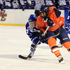 Boston: Salem State freshman Brandon Platt (24) and UMass Boston sophomore Derek Colucci (17) get tangled up while battling for a loose puck during the Vikings Frozen Fenway game against UMass Boston on Tuesday afternoon. The Vikings fell to the Beacons 4-2. DAVID LE/Staff Photo