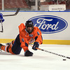 Boston: Salem State senior forward Mark MacDonald (6) dives to poke the puck out of the Vikings zone during the Vikings Frozen Fenway game against UMass Boston on Tuesday afternoon. The Vikings fell to the Beacons 4-2. DAVID LE/Staff Photo