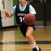 DAVID LE/Staff photo. Essex Tech freshman Virginia Vienneau brings the ball up court at practice. 1/14/16.