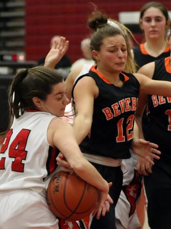 DAVID LE/Staff photo. Salem senior Nicole Sadoway (24) rips a rebound away from Beverly senior Alicia Cecchini (12). 1/19/16.