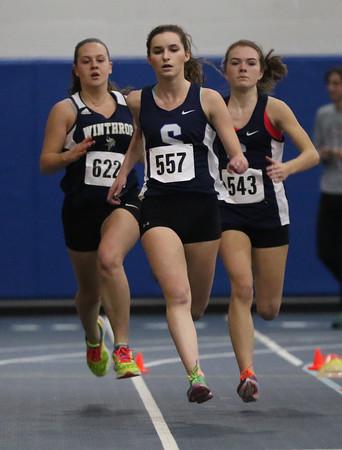DAVID LE/Staff photo. Swampscott  senior Miranda Nocera, center, leads the girls 300 meter race. 1/14/16.