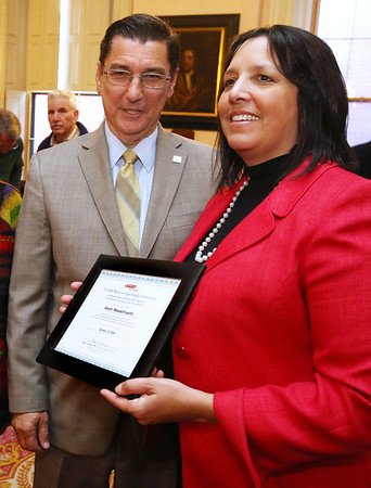 KEN YUSZKUS/Staff photo.     The AARP State director, Mike Festa, left, presented a certificate for an age friendly community to Salem Mayor Kim Driscoll.    1/19/17