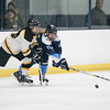 Bishop Fenwick's Jill Mattucci fights Peabody's Carolyn Garafoll for the puck in their game at the McVann-O'Keefe Skating Rink. 1/27/17