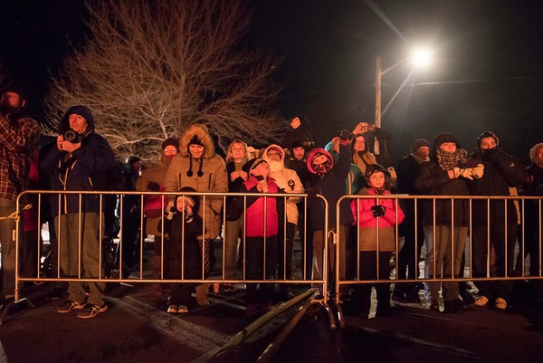 The crowd watches as Christmas trees burn in Salem's 14th annual Christmas tree bonfire at Dead Horse Beach. 1/6/17