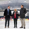 SAM GORESH/Staff photo. From left: Peabody mayor Ted Bettincourt, Sally Driscoll and her son Sean Driscoll stand on the ice before Sally and Sean are presented with a framed jersey in honor of  Sally Driscoll's husband and Sean Driscoll's father Bob Driscoll before the inaugural 'Can Do' Classic between Masconomet Peabody. Bob Driscoll, who passed away in 2016 was a Masconomet hockey coach and long-time Peabody resident and city councilor. 1/2/17