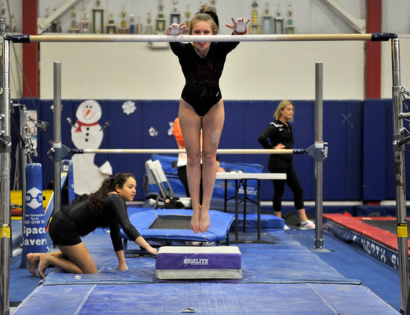 NICOLAS TANNER/Photo.     Aisha Gahm-Diaz competes in the bars on the Gloucester high school gymnastics team against Beverly high school at a meet held at the Sterling Center YMCA in Beverly. 1/19/17