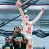 Beverly senior Kevin Mordancy jumps for the ball over Lynn Classical senior Gilbert Minaya in their game at Beverly High School. Lynn Classical won the game 68-65. 1/27/17