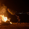 Lieutenant Scott Hebert of the Salem Fire Department throws a Christmas tree on the bonfire during Salem's 14th annual Christmas tree bonfire at Dead Horse Beach. 1/6/17