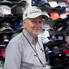 SAM GORESH/Staff photo. Alan Forbes, owner of Sports Collectibles in Peabody Square poses for a portrait wearing an AFC Championship hat in his store. 1/26/17