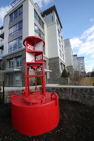 restored Coast Guard buoy in front of Elliott Landing
