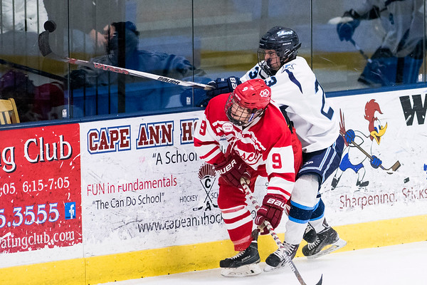 SAM GORESH/Staff photo. Masconomet senior Brandon LaFata attempts to block Peabody junior Ethan Leblanc in the inaugural 'Can Do' Classic. The game ended in a 3-3 tie. 1/2/17