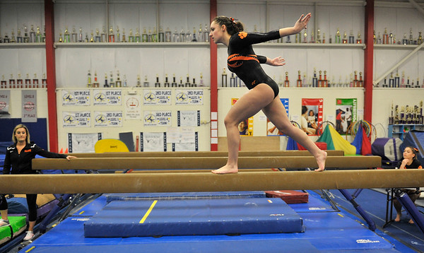 NICOLAS TANNER/Photo.    Kara Macgilvray, a senior at Beverly High School, competes on the beam during a meet against Gloucester held at the Sterling Center YMCA in Beverly. 1/19/17