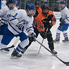 SAM GORESH/Staff photo. Danvers junior Conor Purcell takes control of the puck as Beverly  sophomore Andrew Shea attempts to stop him on defense in their game at Bourque Arena. 1/6/17