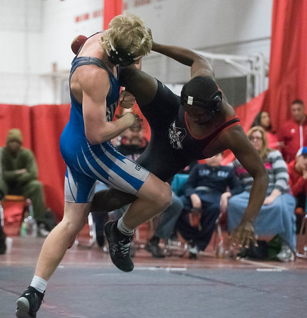 SAM GORESH/Staff photo. Salem's Tyrese Elmidor wrestles Danvers's Russ Canova in the 160 pound bout in their meet at Salem High School. 1/10/17
