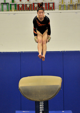 NICOLAS TANNER/Photo.    Alanha Guy, junior, dismounts from a vault while competing on the Beverly high school gymnastics team against Gloucester high school, at a meet held at the Sterling Center YMCA in Beverly. 1/19/17
